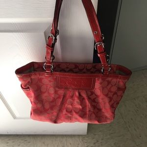 Red fabric Coach purse
